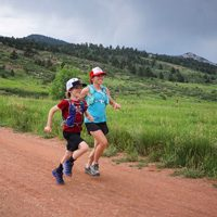 Melissa Raguet-Schofield running with son