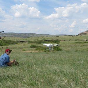 Students operating a drone in the field