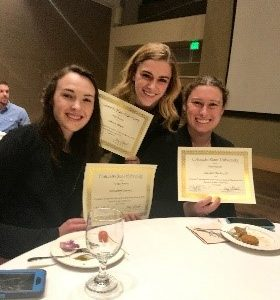 Elizabeth Larson, Carson Black, and Rachel Bockrath receiving Awards for their projects at the 2018 Celebrate Undergraduate Research and Creativity