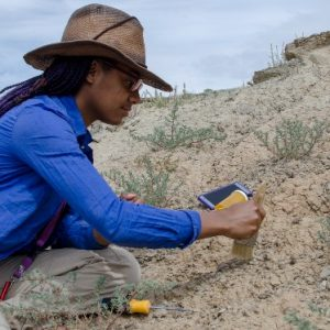 Aiesha Augustin prospecting for fossils at the 2018 Paleontology Field School in the Bighorn Basin of Wyoming