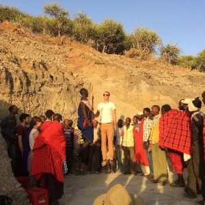 Matthew Muttard participating in the Jumping Dance with Maasai during fieldwork in Olduvai Gorge, Tanzania