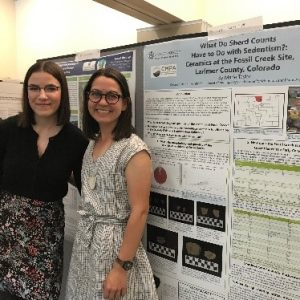 Erica Bradley and Marie Taylor presenting archaeological research from data collected at the 2017 field school at the Senior Capstone Poster Symposium