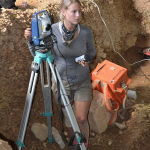 Grace Ellis, Anthropology and Geography PhD candidate, works with the total station, optical surveying instrument, at Lapa do Picareiro, Portugal