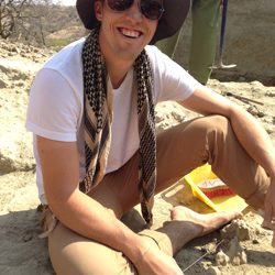 Anthropology student smiling while working in the field