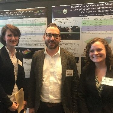 Dr. Michael Pante and students present posters at professional conferences.